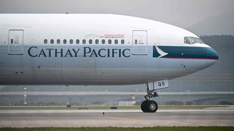Cathay Pacific là hãng bay nổi tiếng của Hong Kong còn ICO làcơ quan độc lập giám sát việc đảm bảo quyền tự do thông tin vì lợi ích cộng đồng. Ảnh: AFP.
